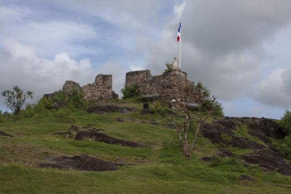 The ruins of the Fort St Louis with a French flag flying over it | Saint Martin | Saint Martin