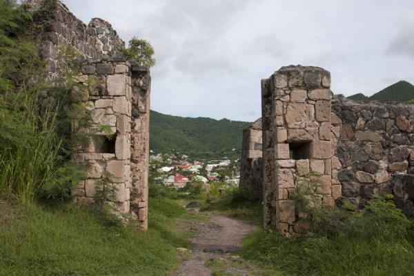 Gate of the Fort St Louis, with modern houses in the background | Fort St Louis | Saint Martin
