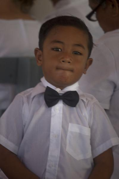 Picture of Falealupo (Samoa): Young boy with bow tie during church service