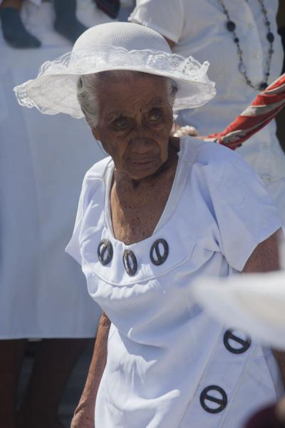 Foto di Old Samoan woman dressed in white coming out of church after service - Samoa - Oceania