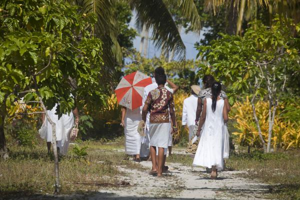 Picture of People dressed in white going back home after churchFalealupo - Samoa
