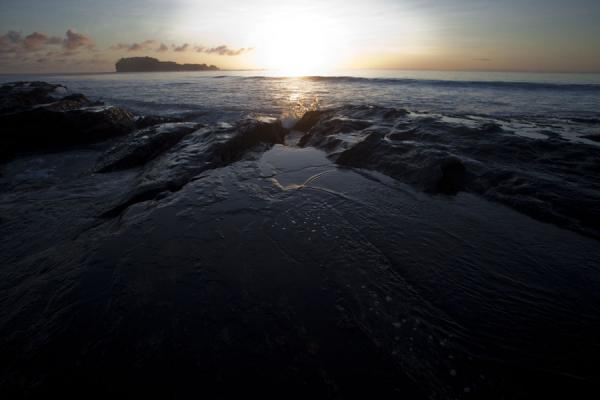 Picture of Namua island (Samoa): Sun rising over the slippery rocks east of Namua island, the very first sunrise of the planet