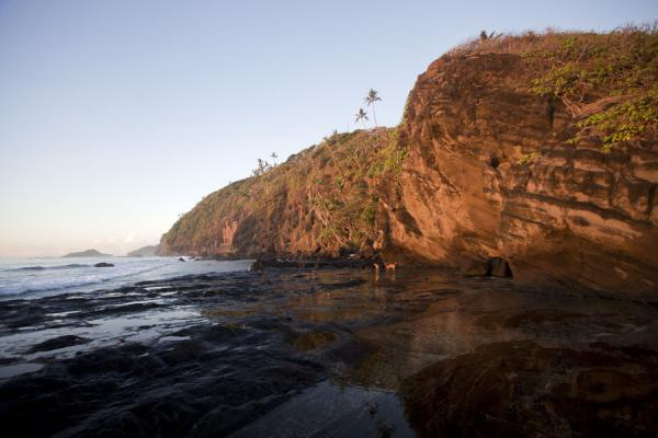 Picture of Namua island (Samoa): Cliffs on the eastern side of Namua island basking in the early morning sunlight