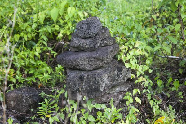 Pile of black stones on top of Pulemelei ancient mound | Pulelemei ancient mound | Samoa