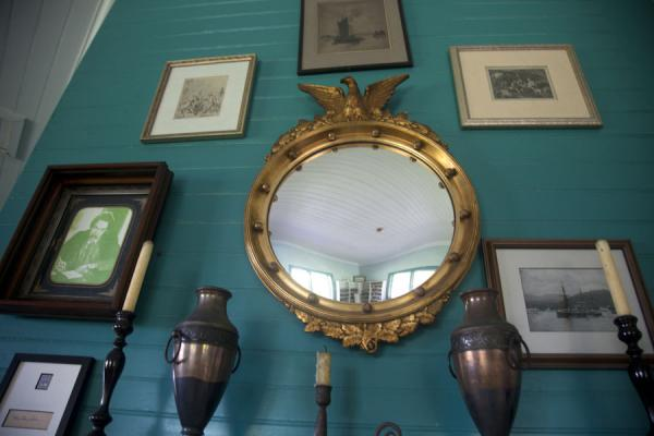 Wall with pictures and mirror in the library of the museum | Robert Louis Stevenson Museum | 萨摩亚群岛