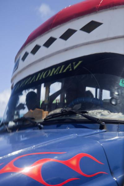Picture of Samoan buses (Samoa): Reflection of a Samoan bus in its mirror