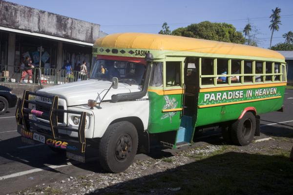 Picture of Samoan buses (Samoa): Green and yellow Paradise in Heaven bus in Salelologa on Savai'i island