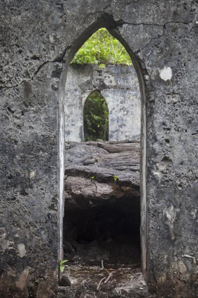Window of LMS church with a thick layer of lava inside | Champs de lava de Savai'i | Samoa