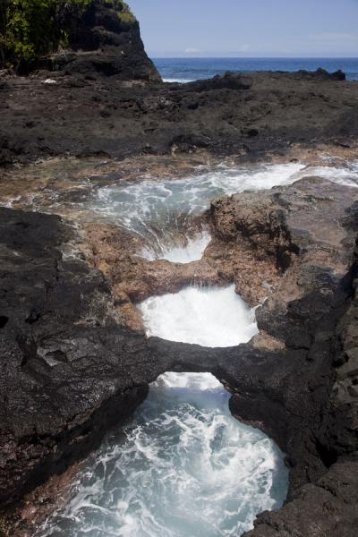 Picture of Waves flowing under a natural lava bridge on the coast off To SuaTo Sua - Samoa