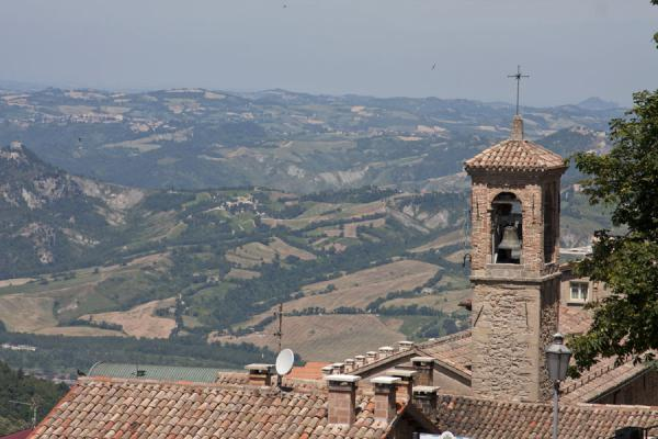 Landscape of San Marino with bell tower of the Convento dei Cappuccini in the foreground | Historic City of San Marino | San Marino