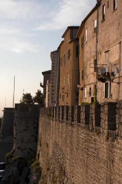 City wall and part of the historic centre of San Marino before sunset | Historic City of San Marino | San Marino