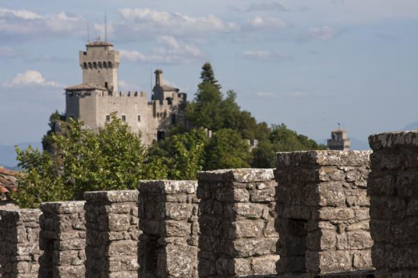 The Second Tower, or Cesta, seen from behind the crenellated walls of the First Tower, or Guaita | Three Towers of San Marino | San Marino