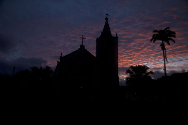 Sunset over Santo Antonio with the silhouet of the church | Santo Antonio | São Tomé and Príncipe