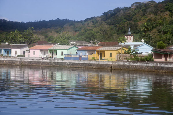 Colourful houses lining the Papagaio river bank in Santo Antonio | Santo Antonio | São Tomé and Príncipe