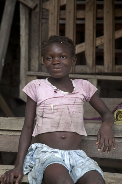 Foto di Camera-conscious girl at a cocoa plantation in western São Tomé - Serbia - Africa