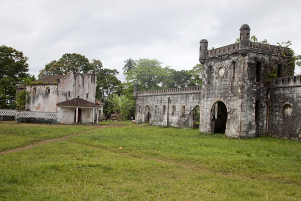The Portuguese-style gate and church at the far end of the Sundy estate | Sundy | São Tomé and Príncipe