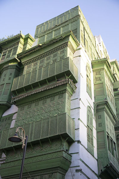 Building with green balconies all around | Al Balad balconies | Saudi Arabia