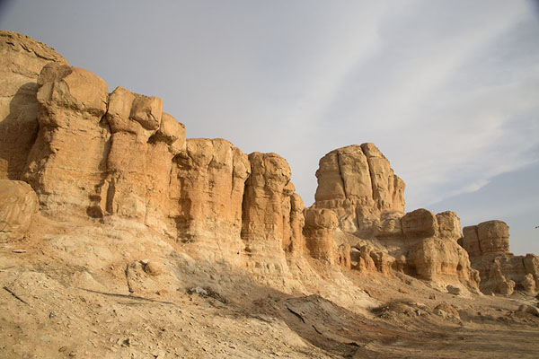 Row of rocky pillars on the southside of Qara mountain | Al Qara mountain | Arabia Saudita