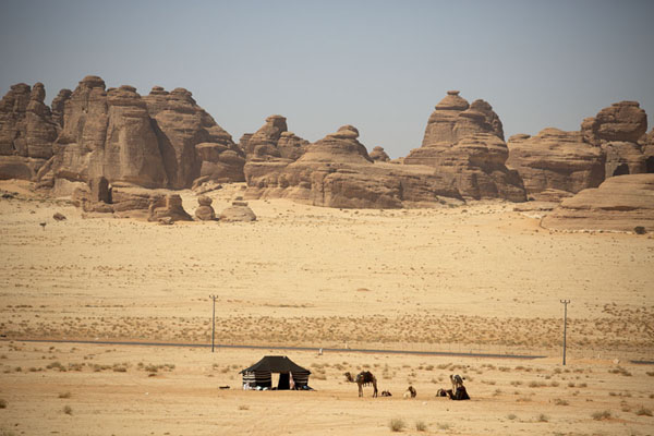 Bedouin tent with camels and the rocky landscape near Hegra | Al Ula rock formations | Saudi Arabia