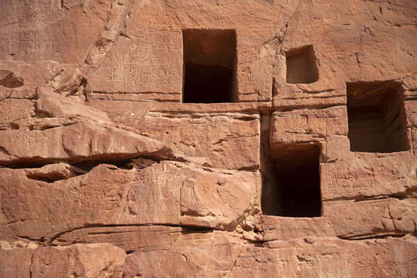 Foto van Close-up of tombs with texts carved into the rock face in Jebel KhuraybahDadan - Saoedi Arabië