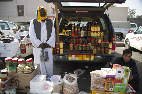 Olives, nuts, and other items for sale from the open hatch of a car | Hail Friday Market | Saudi Arabia