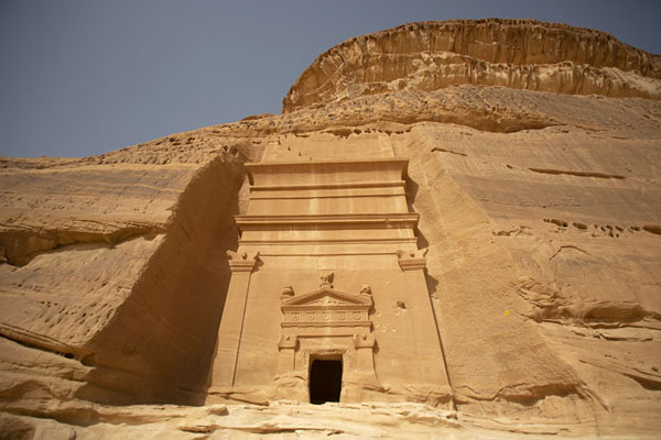 Looking up one of the mightiest tombs carved out at Qasr Bint | Hegra | Saudi Arabia