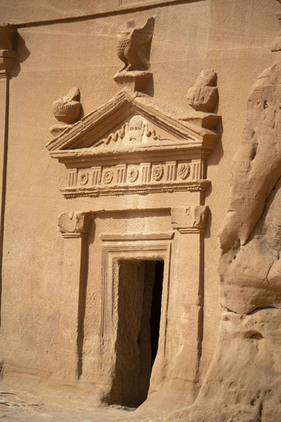 Picture of Griffin, snakes, and a head are among the decorations carved out of the rock to embellish this tomb at Qasr BintMada'in Saleh - Saudi Arabia