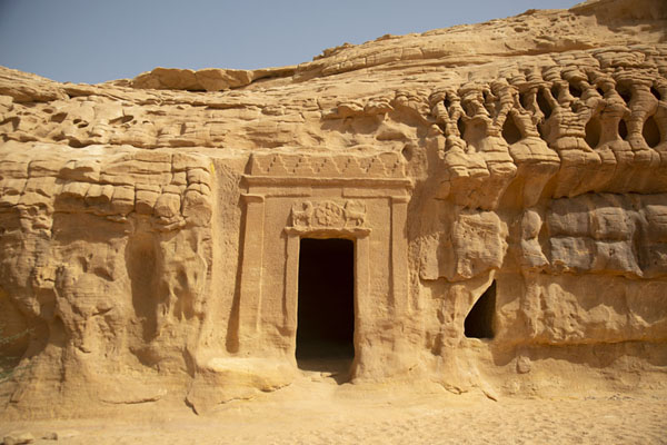 One of the carved Nabatean tombs with two lions at Qasr al Bint | Hegra | Arabia Saudita