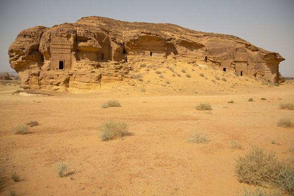 Foto van The monolith of Jebel al Ahmar is full of tombs all aroundMada'in Saleh - Saoedi Arabië