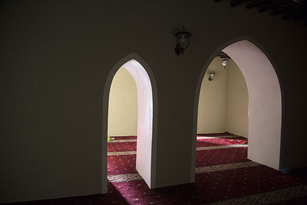 Light shining through two arched openings in the wall of Jawatha mosque | Jawatha mosque | Saudi Arabia