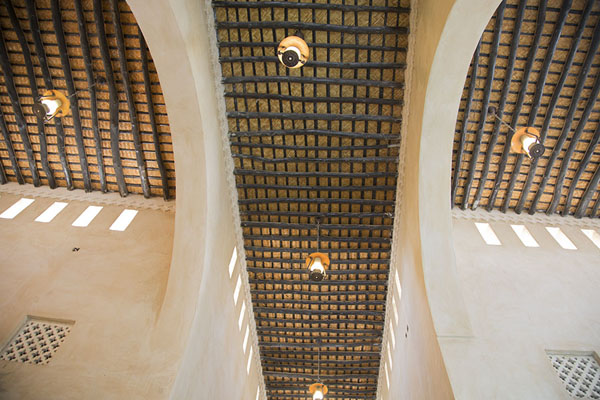 Foto van The ceiling with wooden beams gives a hint that Qaisariah souq is a historical buildingAl Hofuf - Saoedi Arabië