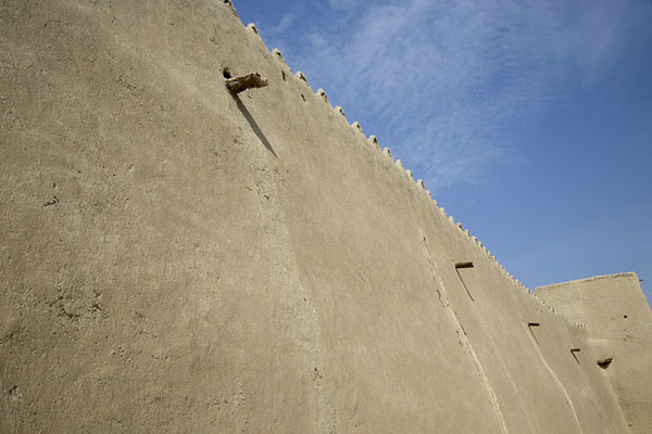 Looking up the crenellated wall of Qasr Ibrahim | Qasr Ibrahim | Saudi Arabia