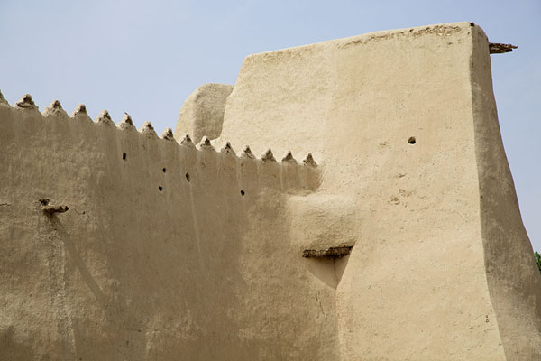 The crenellated wall of Qasr Ibrahim with square tower | Qasr Ibrahim | Saudi Arabia
