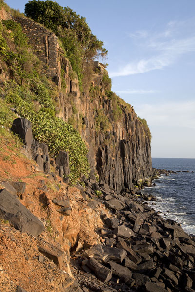 Afternoon sun shining on the cliffs of Le Castel on the southern coast of Gorée island | Ile de Gorée | Senegal