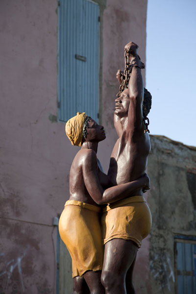 Statue of enslaved couple breaking chains outside the Slave House | Ile de Gorée | Senegal