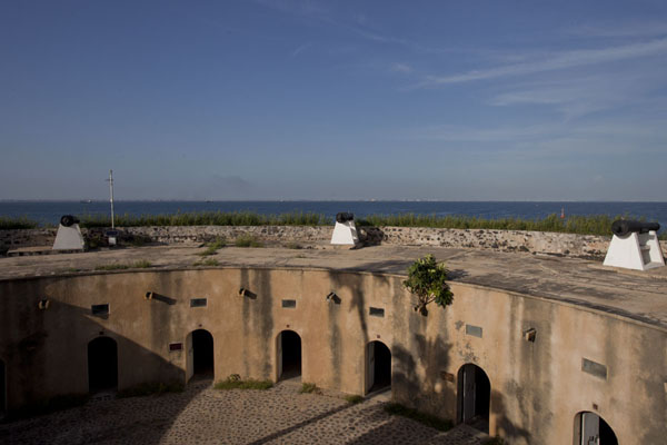 Looking out over the cannon-guarded walls of the Fort d'Estrées, now housing a museum | Ile de Gorée | Senegal