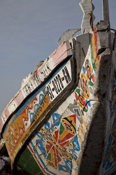 Decorated pirogue docked at the shore of Saint Louis | Saint Louis Senegal | Senegal