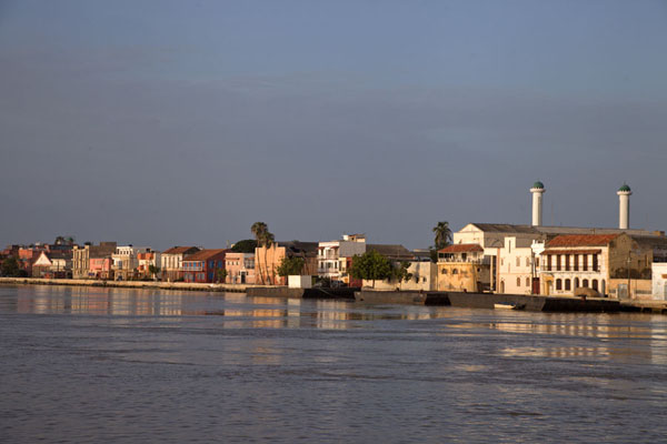Houses of Saint Louis reflected in the Senegal River in the early morning | Saint Louis Senegal | Senegal