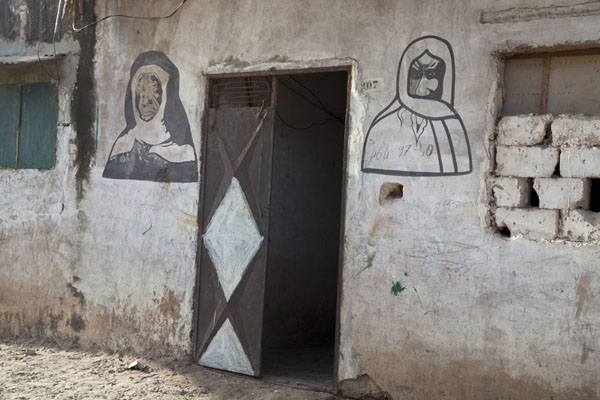 House with man and woman painted on the wall | Saint Louis Sénégal | Senegal