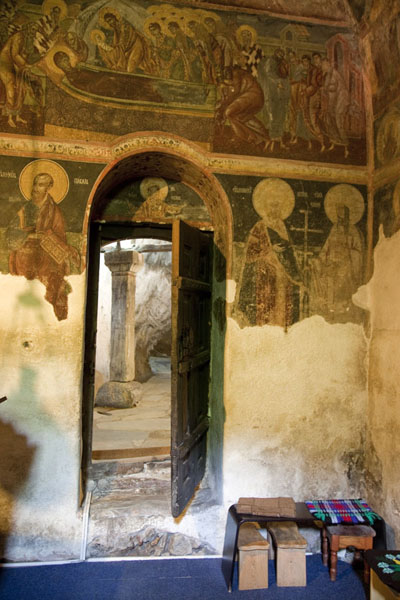 Picture of Entrance door surrounded by wall paintings inside Crna Reka church