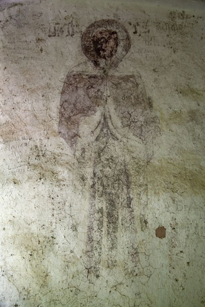Painted saint on the exterior wall of the church | Crna Reka monastery | Serbia