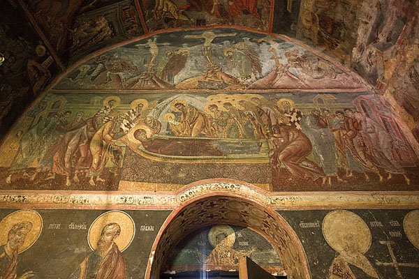Colourful frescoes decorate the wall of the nave of Crna Reka church | Crna Reka monastery | Serbia