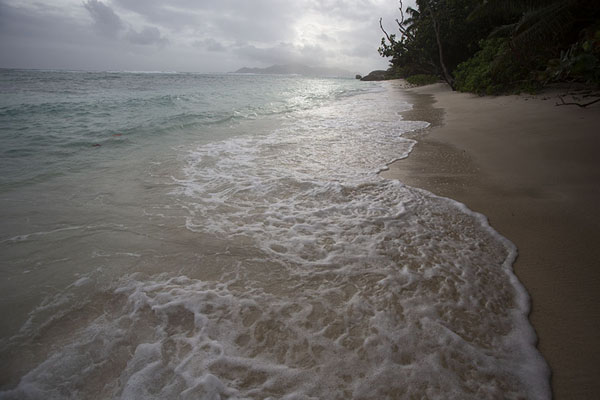 Granite formations at the end of Anse Cocos, La Digue | Seychelles beaches | Seychelles