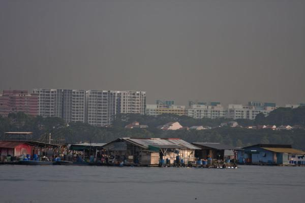 Houseboats off the coast of Pulau Ubin with the skyline of Johor Bahru in the background | Pulau Ubin | Singapore