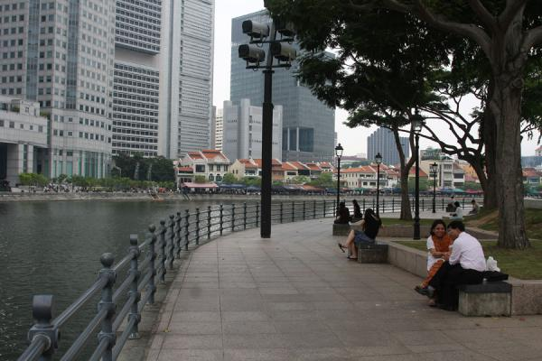 People chatting on a bench on Singapore River near Boat Quay | Singapore River | Singapore