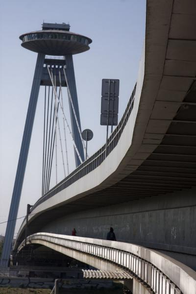 Pedestrian layer with UFO, pillars and steel cables in the background | Bratislava New Bridge | Slovakia