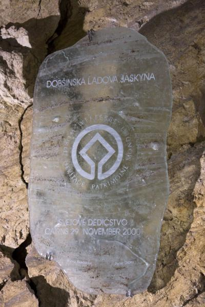 The sign stating that Dobinska Ice Cave is inscribed in the Unesco World Heritage List, made of ice | Dobinska Ice Cave | Slovakia