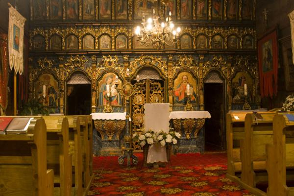 Interior of the wooden church of Jedlinka with the baroque altarpiece | Protection of Mother of God church | Slovakia