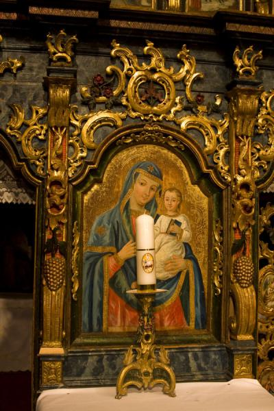 Mother Mary and Jesus depicted in an icon in the wooden church of Jedlinka | Protection of Mother of God church | Slovakia