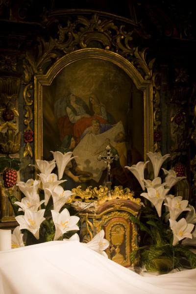 Picture of Icon of the Mother of God surrounded by flowers in the wooden church of Jedlinka - Slovakia - Europe